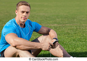 Attractive young athlete is relaxing after running -...