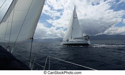 Sailboats participate in sailing regatta. Sailing. Yachting....