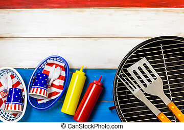 July 4th - Small round charcoal grill ready for grilling at...