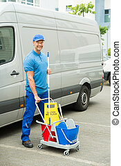 Cleaner In Front Of Van With Cleaning Equipments - Happy...