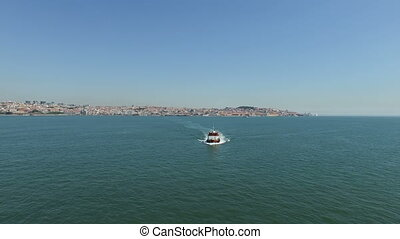 Aerial from ferry boats in Lisbon - Aerial from ferry boats...