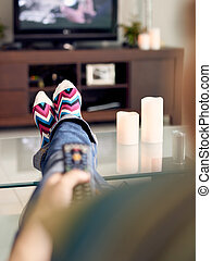 Woman Relax On Sofa Watching Film On TV With Remote - Young...