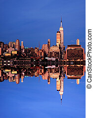 The New York City midtown skyline with a perfect reflection