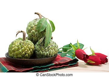 Sugar Apple (custard apple, Annona, sweetsop) on wooden...