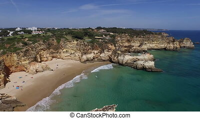 Beach in Alvor Portugal - Aerial from praia Tres Irmaos in...