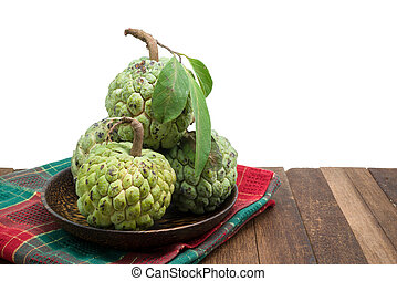 Sugar Apple custard apple, Annona, sweetsop on wooden table...