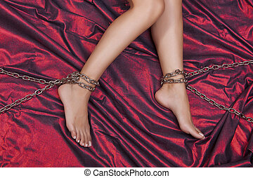 Torture - Woman Legs In Chains On Red Satin