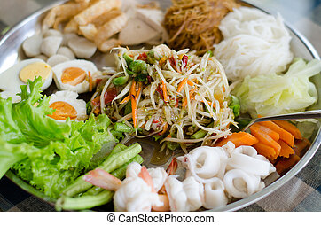 Papaya salad Som Tum on large plate