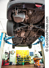 Car on a hoist or elevator to enable a motor mechanic to...
