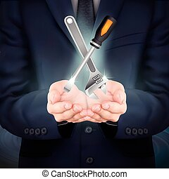 businessman holding tools set - close-up look at businessman...