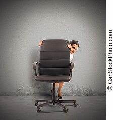 Businesswoman hiding - Businesswoman in the office behind a...