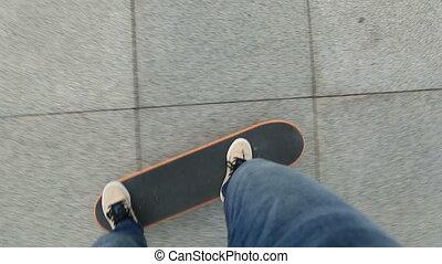 skateboarder legs riding skateboard
