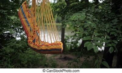 hammock swings - empty swing hammock swinging in the wind