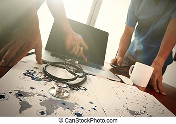team doctor working with laptop computer in medical...