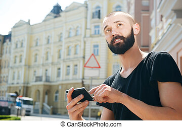 Attractive young bearded man got lost in city - Handsome...