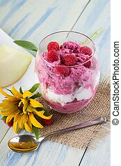 Glass cup with ice cream with spoon and flower - Vertical...