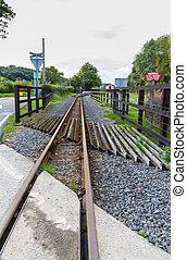 Narrow gauge railway or railroad track converging into...