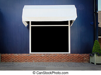 Shopfront vintage store front with canvas awnings and blank...