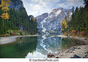Autumn in Alps. - Idyllic lake surrounded by colourful...