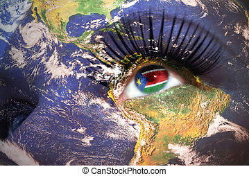 womans face with planet Earth texture and South Sudan flag...