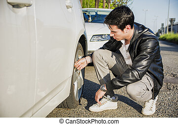 Handsome Man Sitting Besides the Wheel of Car