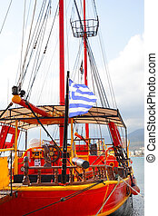 Old sailing ship with Greek flag