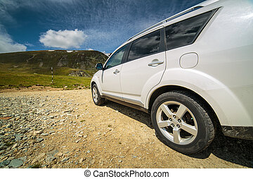 Offroad car near the mountains - Offroad car SUV at the...