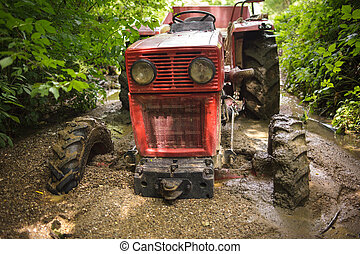 Tractor stuck in the mud
