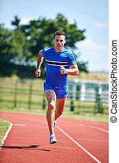 Runner sprinting - Young athlete runner, sprinting on the...