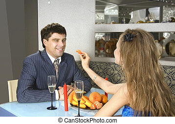 a pair of lovers at restaurant - a pair of happy lovers at...