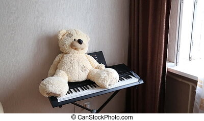 Teddy on piano