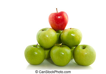 apples - stacked green apples with one red on top