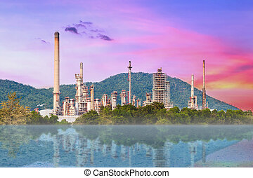 Oil refinery at twilight with reflected on the river