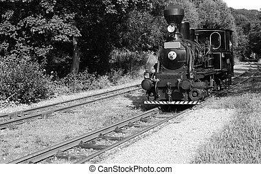 Old train - Ancient steam locomotive on a vintage railroad -...