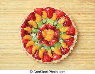 Fruit Flan - A delicious homemade fruit flan on a wooden...