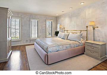 Master bedroom with wood floors