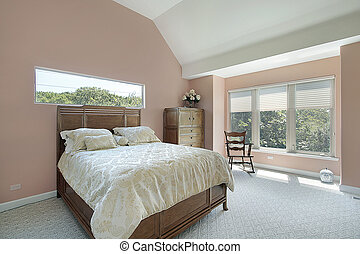 Master bedroom with mauve colored walls