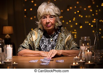 Fortune teller with tarot cards - Picture of mature fortune...