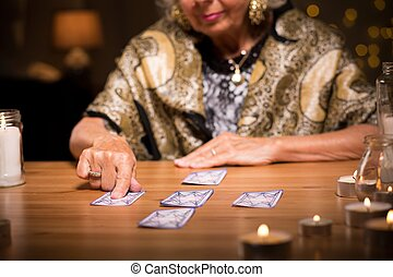 Woman predicting future - Photo of elder woman predicting...