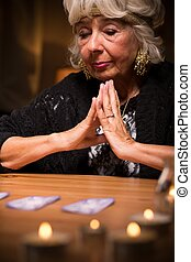 Magic woman during spiritualistic seance - Image of grey...