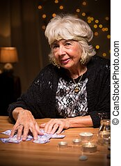 Smiling tarot reader - Picture of smiling aged tarot reader...