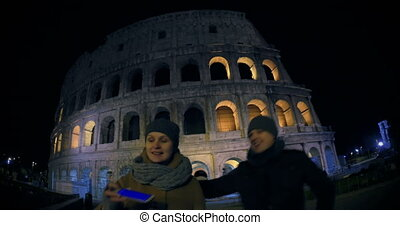 Young couple making selfie near Coliseum - Wide angle shot...
