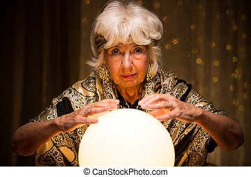 Mystique woman with magic ball - Image of elder mystique...