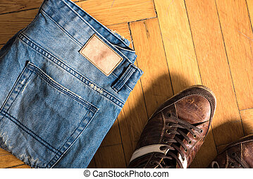 Shoes and jeans on the floor - Brown shoes and blue jeans...