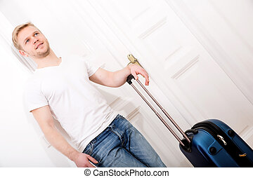 Traveller - A young man going to travel with a suitcase
