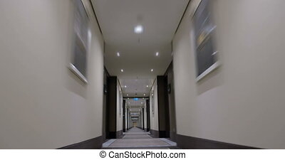 Timelapse of moving forward in empty light hotel corridor -...