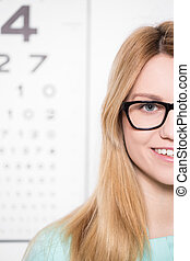 Wearing glasses with black rims - Beauty woman wearing...