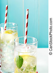 Two iced lemonades with big red striped straws