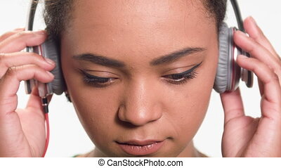 lovely woman listening her favorite song - closeup portrait...