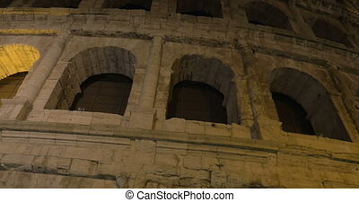Famous Roman sight Coliseum at night - Dolly and low angle...